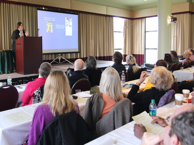 Mary presenting at a conference